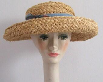 straw hat . Kaminski . kaminski hat . raffia hat . made in Madagascar . Helen Kaminski. hand woven hat