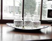 Vintage apothecary jars on a silver plate tray - pressed glass organization organized trio three
