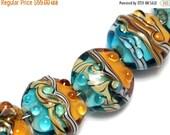 ON SALE 30% OFF Seven Amber Ocean Lentil Beads -10405502-Handmade Lampwork Glass