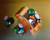 Mod vintage 50s copper  set:  assymetric cuff bracelet with a multicolor cobochons and clip on earrings. Made by Renoir Matisse.