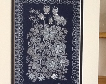 An Original pen and ink drawing of delicate flowers with a lace border