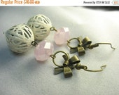 White filigree earrings ... white filigree bead, pearly pink glass and antique brass bows ... antique shabby chic