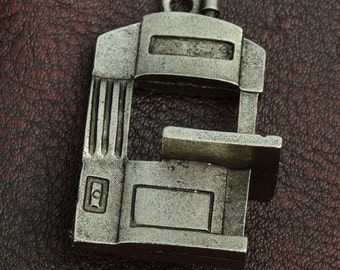 Band Saw Charm/pendant 23mm tall x 12mm  , sold  zinc cast and plated, sold by each 15313