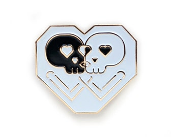 Kissing Skulls Gold enamel pin