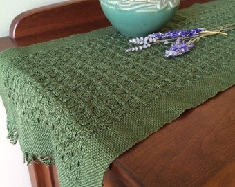 Moss green handwoven table runner in textured lace weave