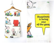 Vintage 1970s Peanuts Top twin Flat Sheet Fabric Happiness is Being One of the Gang 1971 Snoopy Charlie Brown Lucy Linus Woodstock Dell's