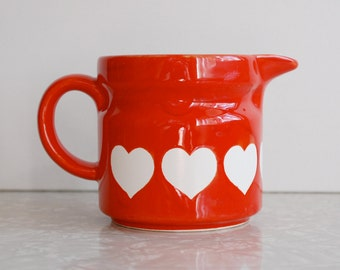 heart creamer/small pitcher by Relpo of Chicago, made in Japan with bright, 80s red and white graphics, collectible vintage modern creamer