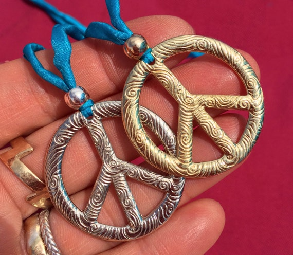 Large White or Yellow Brass Peace Vibe Necklace hung on turquoise silk cord