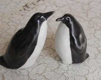 pair of porcelain penguins, black and white birds, tuxedos