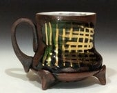 Dark mug with gold luster