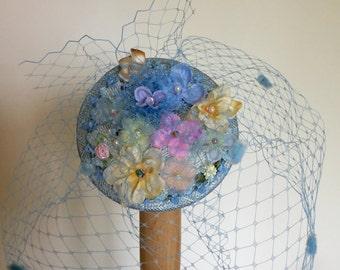 Blue fascinator, floral wedding hat, birdcage veil.