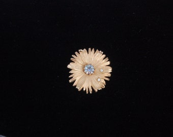 Vintage Unmarked Matte Gold Tone Textured Flower Brooch with Aurora Borealis Rhinestone in Center with Two White Rhinestones