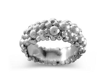 Molecule eternity ring silver 8mm wide