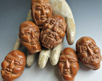 Carved Chinese Immortal Face Olive Beads