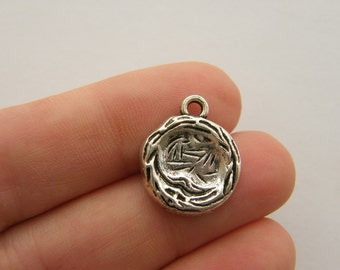 4 Nest charms antique silver tone B161