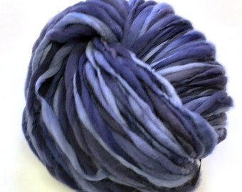 Handspun yarn, 95 yards and 3 ounces/86 grams spun thick and thin in hand dyed merino wool