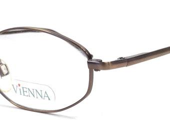 vintage 90s deadstock eyeglasses matte bronze metallic brown metal stainless steel oval frames eye glasses eyewear optical vienna simple 119