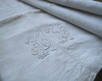 Beautiful Antique French hemp, linen sheet with glorious monogram ML.  Great tablecloth fabric.
