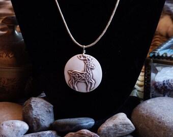 Handmade, relief carved porcelain Celtic Buck pendant/necklace