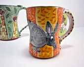 Ceramic Coffee Mug Armadillo Pottery Clay Majolica 16 ounce on orange