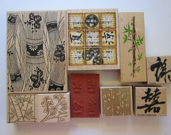 12 rubber stamps - ASIAN theme stamps, bamboo, cherry blossoms, text, characters, coins - gently used