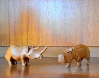 vintage hand carved wooden hippo and rhino figurines