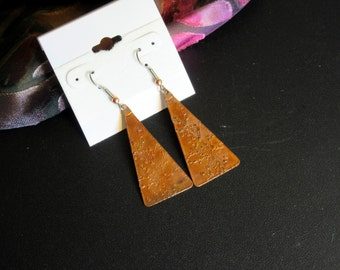 Hand crafted etched copper triangles dangle from surgical steel ear wires