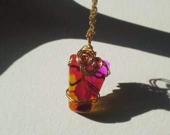 Pink, red, and amber resin pendant
