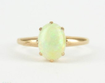 Antique Opal Single Stone Ring in 9 Carat Yellow Gold. Oval Opal Cabochon Ring, Circa Late Victorian.