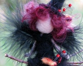 Halloween witch ornament on broomstick Needle felted Waldorf inspired doll