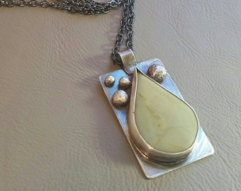 Sterling silver oxidized green teardrop mystery stone. Unique statement