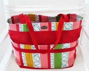 Large red tote // long webbing straps // outside pockets // inside pockets