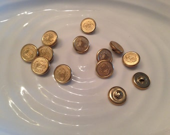 All the same button - 13 vintage gold metal shank buttons