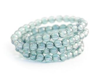 NEW Pressed Czech Glass Ceylon Druk Beads, Smooth Round Spacer Beads, Translucent Blue Denim Luster (4mm) x 50