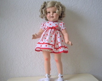 Shirley Temple Doll.  All Composition. 1930s.  New wig, shoes, dress and sailor outfit.  18 inches.