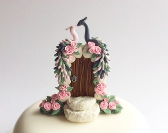 Peacock wedding cake topper in slate grey, blush pink and sage green colours handmade from polymer clay