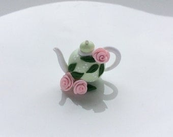 Miniature teapot in pale green with pink roses for 1:12 scale dollhouse made from polymer clay