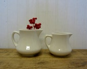 Two Creamy White Pottery Farmhouse Creamers Milk Pitchers