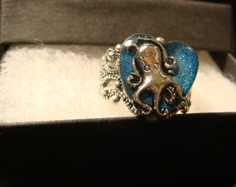 Octopus Heart Filigree Ring in Antique Silver- Glitter Blue Background (2008)