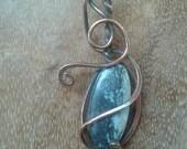 Celestial pendant. Copper wraped.