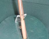 Handcrafted wooden twist type pen/stylus.  Hawaiian Ohia