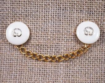 Designer St. John Logo Gold Tone and Cream Enamel Brooch Sweater Pin