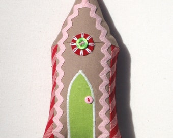 Pink and green gingerbread house with embroidery