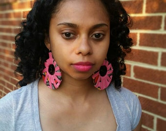 Leather and fabric hoop earrings.
