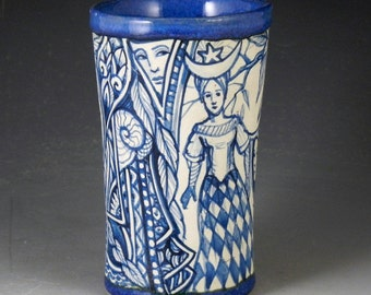 Blue and white one of a kind ceramic story vase