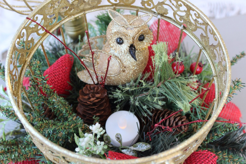 Gold birdcage centerpiece arrangement with by
