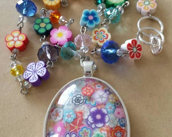 Sale was 24 now 21uk Multicoloured Oval Floral Faux Mille Fiori Pendant on bead and Flower bead Necklace.