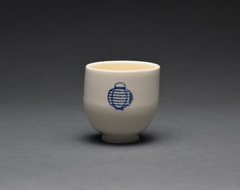 White Ceramic Cup with Paper Lantern
