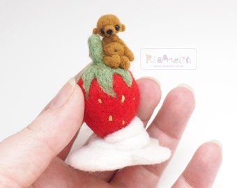 Needle Felted miniature bear with strawberry.