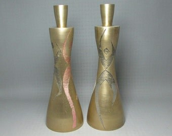 Brass candle holders marked SARNA India , each has a ringer inside so also a bell , mid century modern figures , numbered M335
